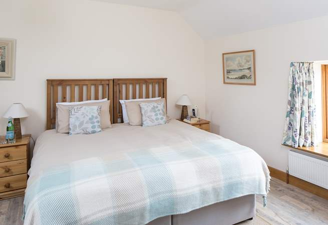 The master bedroom - with 'zip and link' beds - set up here as a super-king size bed, but it can be made up as twin beds if you prefer.