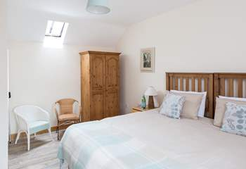 Another view of the master bedroom; one side has windows overlooking the farm buildings and the countryside beyond. The other side has a high Velux window that allows the light to flood in.