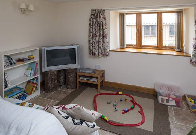 The second sitting-room is set up as a playroom.