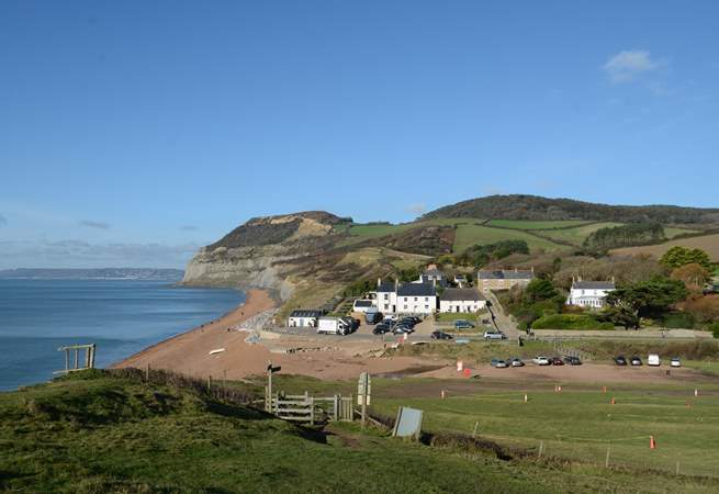 Nearby Seatown, with Golden Cap in the background and the award-winning Anchor Inn in the foreground.