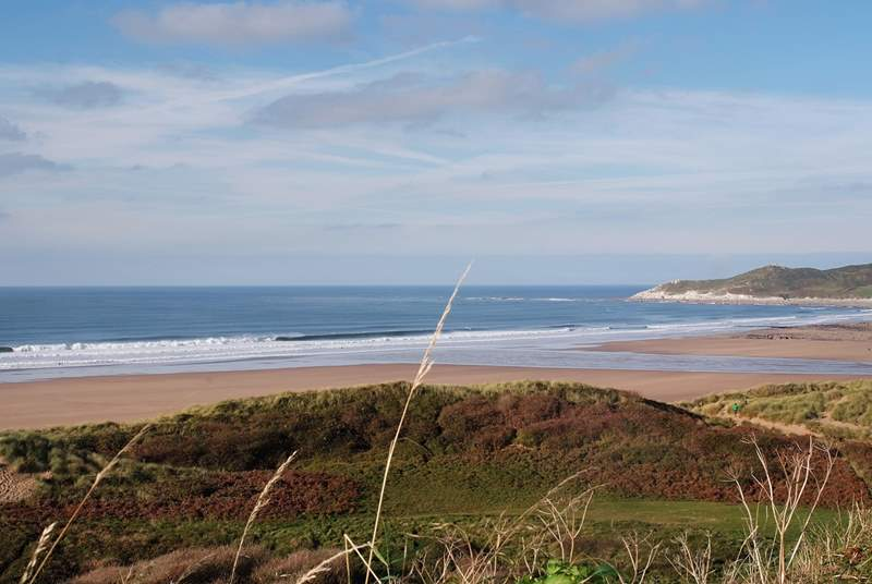 North Devon is home to some of the most spectacular sandy surfing beaches - such fun for all the family. This is Woolacombe.