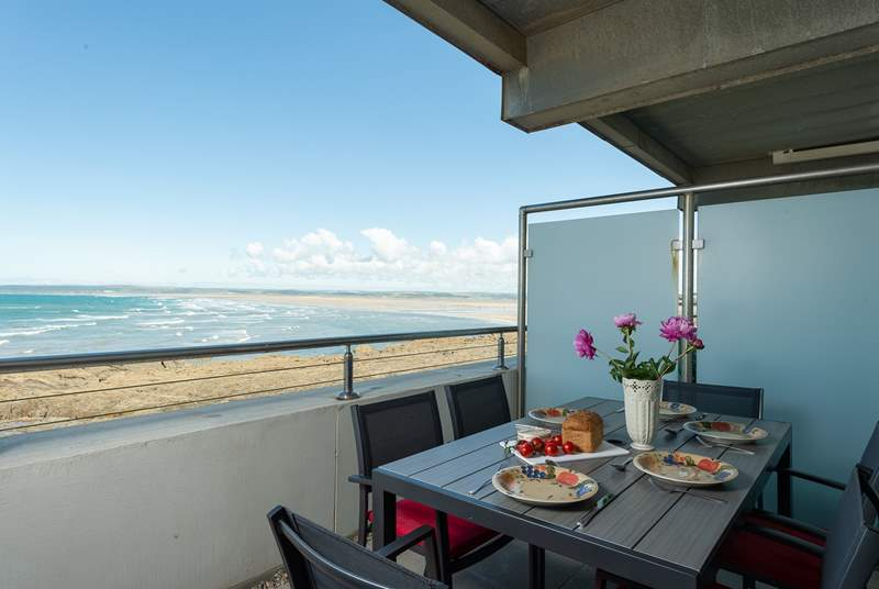 A private balcony with panoramic sea views runs the full width of the apartment with access from the living-room and the main bedroom.