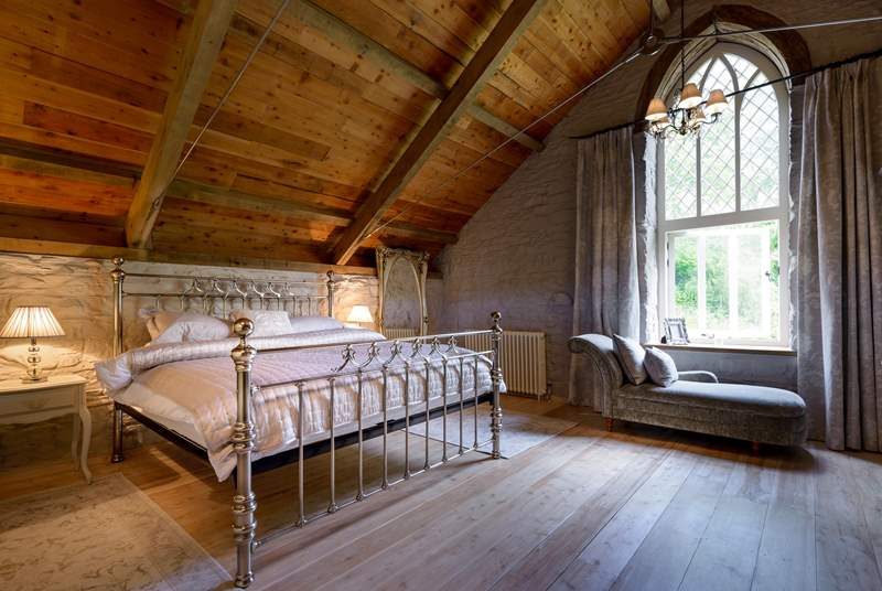 The stunning master Bedroom (Bedroom 5) on the top floor of the mill.