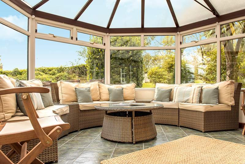 The large circular conservatory is ideal to sit in and enjoy the garden.