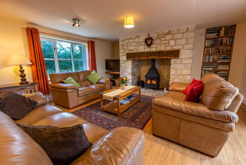 The spacious sitting-room has views to the front of the cottage, and through double doors to the dining/garden-room.