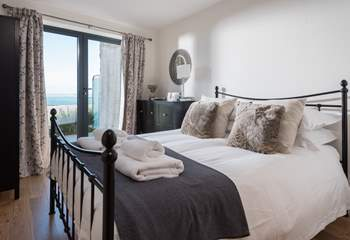 The master bedroom, with patio door leading out onto the balcony.