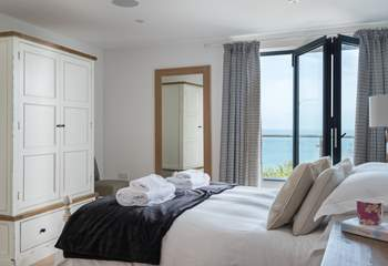 The fabulous main bedroom, with access to the balcony.