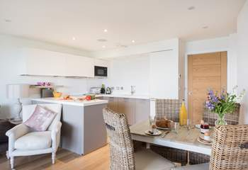 The gorgeous open plan living-area, beautifully furnished in pastel colours.