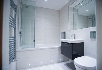 The gorgeous bathroom with Villeroy and Boch bath, wall-mounted wash-basin and WC.