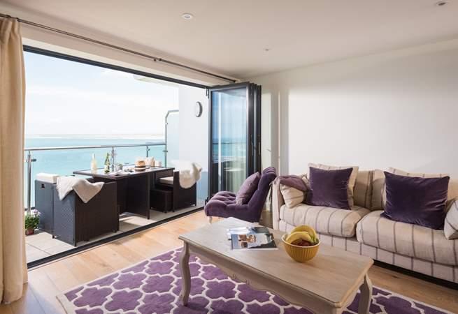 The fabulous open plan living-area has a super balcony to enjoy.