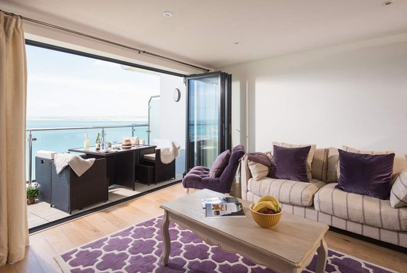The fabulous open plan living-area has a super balcony to enjoy.