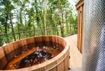 The cedar wood-fired hot tub - a must for the end of the day! The water takes a couple of hours to heat up initially.