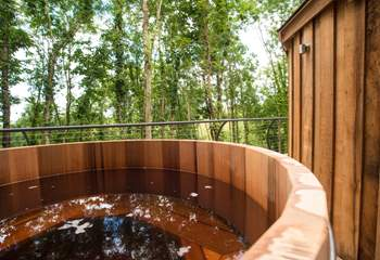 The cedar wood-fired hot tub on the deck.
