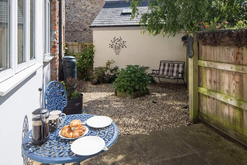 There are two private enclosed courtyard gardens to sit out in, this one is at the rear of the cottage.