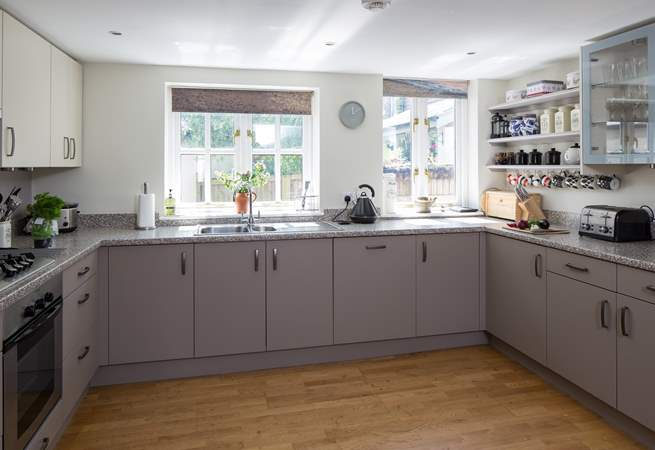 The spacious kitchen - complete with printed blinds of the Jurassic Coast just a few miles away! Your own 'sea view'.