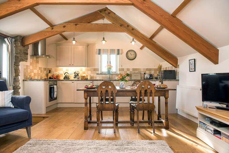 Wooden floors and exposed beams, add to the character of Molly's Barn.
