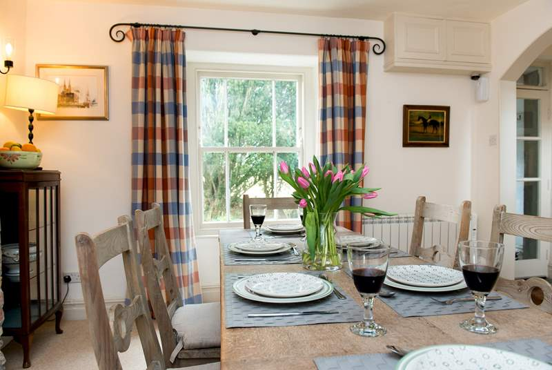 The dining-room enjoys views over the front of the cottage.