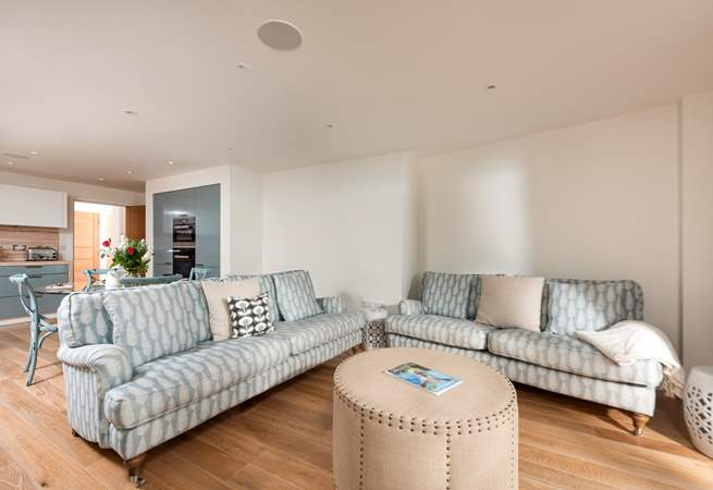 The open plan living area has patio doors which lead out onto the balcony with sea views.