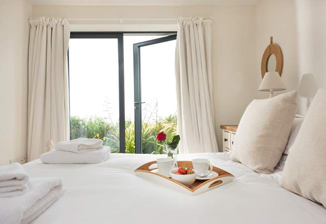 The main bedroom at Windjammer- wake up and watch the boats bob by.