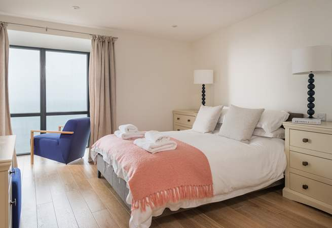 The soft pastel colours complement the master bedroom perfectly.