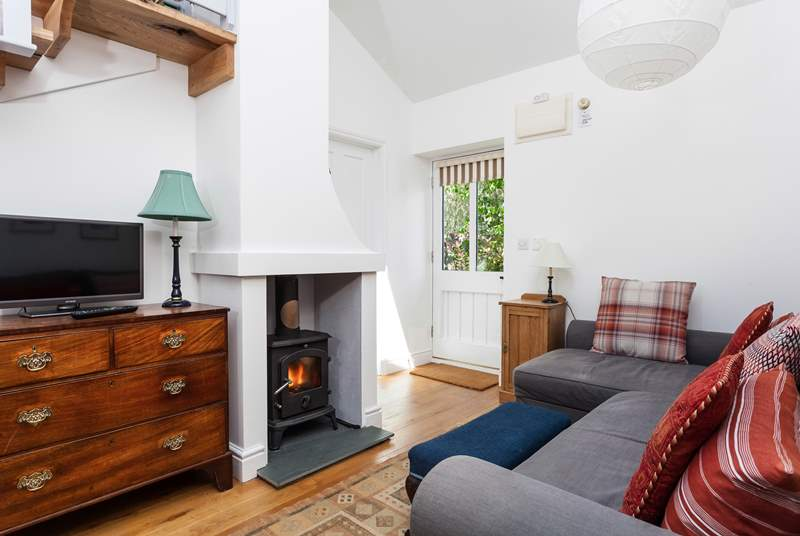 The front door opens into the open plan living-room with a very comfy L-Shaped sofa.