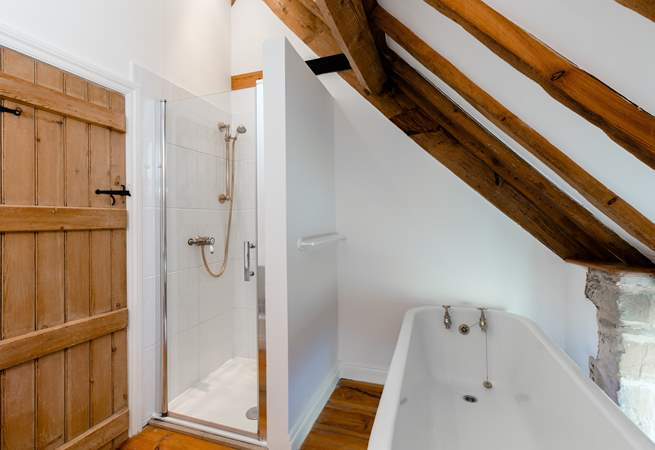 The family bathroom, with roll top bath and separate shower cubicle.