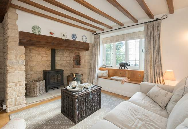 The characterful sitting-room has a wood-burner effect gas stove for extra warmth.