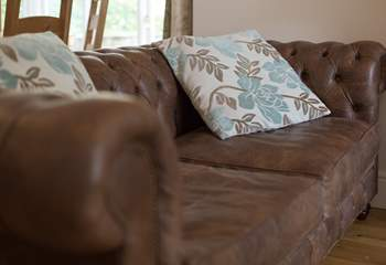 Sink into this Chesterfield sofa and put your feet up after a day out exploring the Exmoor National Park.