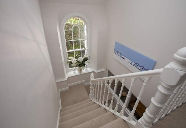 Even the stairwall is striking, with its gorgeous period window overlooking the little lane at the back.