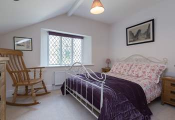 There is also a double bedroom with a view out over the terrace and the wooded hillside.