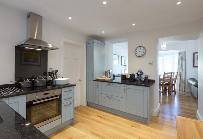 A super contemporary kitchen makes use of some original features to link into the rest of the living-space.