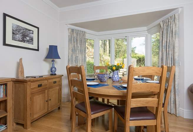 The dining-table has pride of place looking out over the terrace. The French windows open  up to bring the outside in on a warm day.
