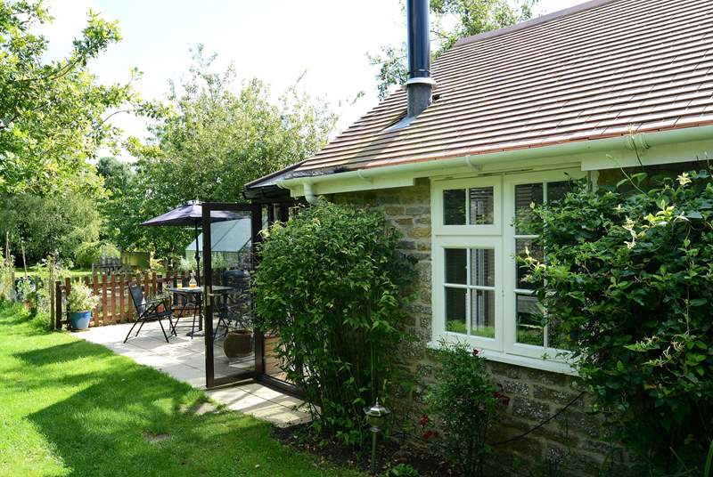 Owl's Nest Cottage is compact and built of local stone, with a sunny conservatory at the far end.
