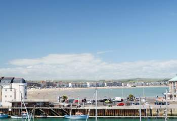 Weymouth's safe and sandy beach, with the harbour in the foreground.