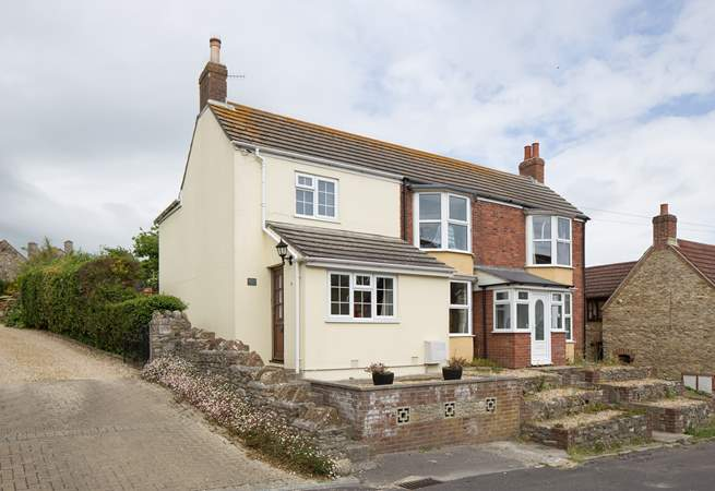 September Cottage is semi-detached in a quiet road; steps lead up from parking directly outside.