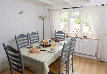 There is plenty of room at the dining-room table for all the family to dine or play one of the games provided at September Cottage.
