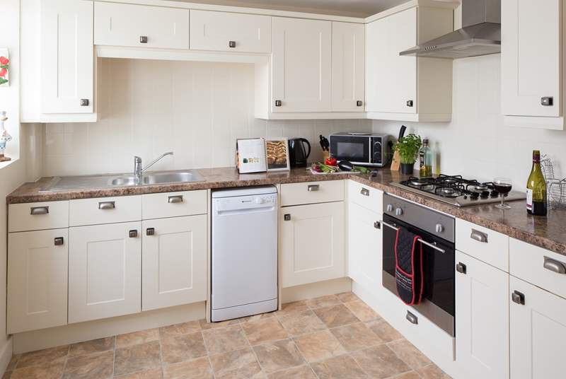 The well-equipped kitchen leads out to the garden-room.