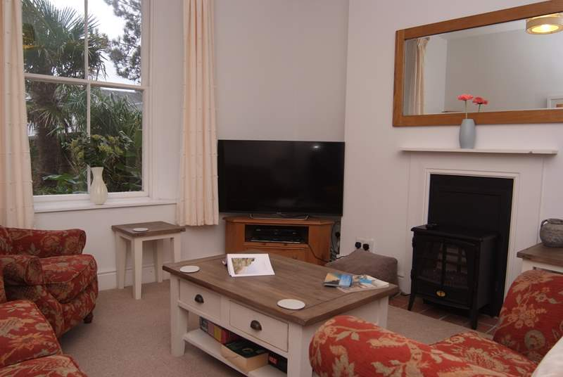 The sitting-room has an electric wood-burner effect stove.