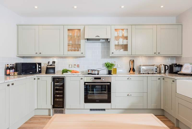 This very stylish kitchen is well-equipped with the latest appliances and the thoughtful Owners have even included a wine cooler.