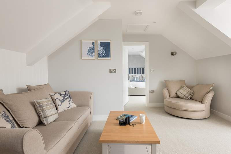 The sitting-room is beautifully and comfortably furnished and sits between the bedroom at one end of the apartment and the kitchen at the other.