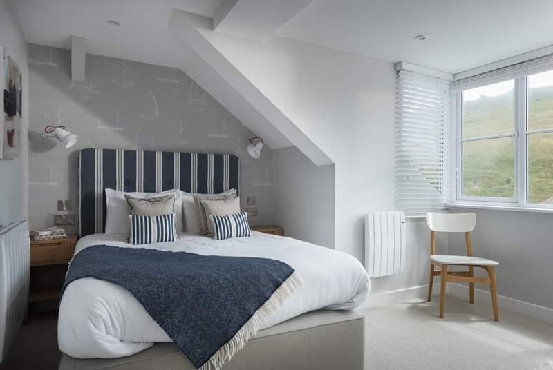 The gorgeous bedroom with king-size bed dressed with crisp cottons and comfy pillows and en suite shower-room.