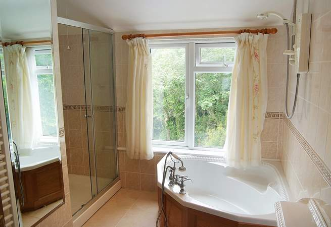 The very spacious bathroom has a corner bath, electric shower and large shower cubicle, something for everyone.