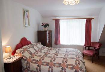 The bedroom is comfortably furnished with a double bed and has plenty of storage.