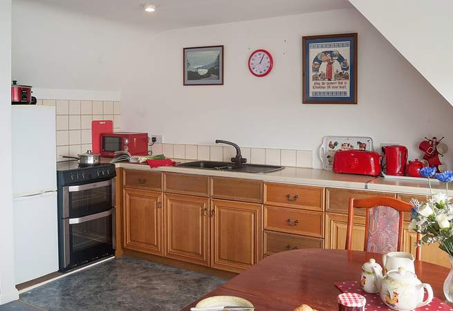 The well-equipped kitchen is to one side of the open plan living-room.
