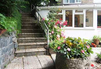 There are two flights of steps leading up to the front door with your parking space close by in front of the property.
