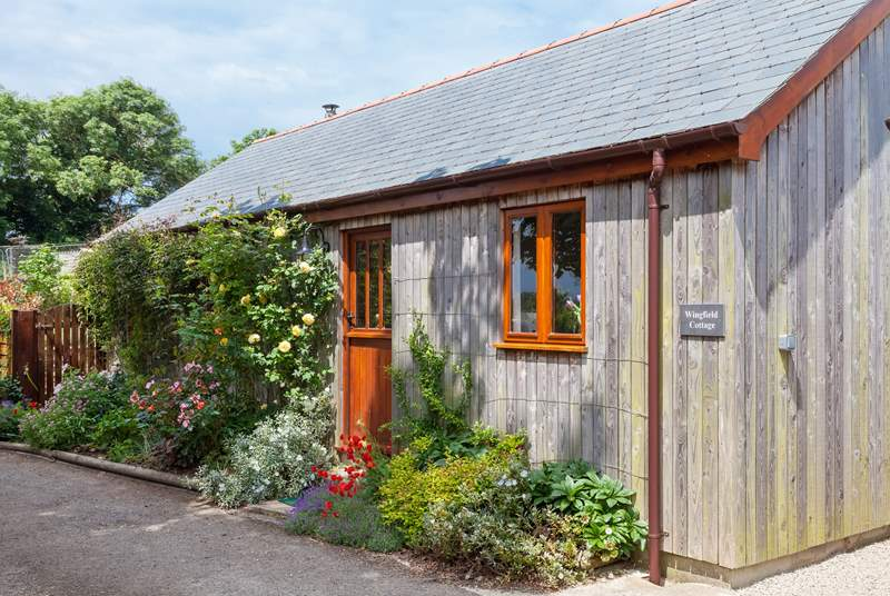 The delightful cottage has the look and character of a traditional cabin.