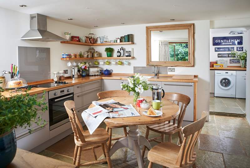 The contemporary kitchen/dining-room not only suits the cottage perfectly, but has everything you need to enjoy your holiday here, with plenty of worktop space too.
