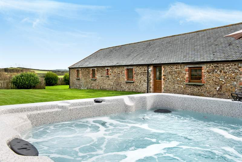 Enjoy time relaxing in the hot tub- what a treat!