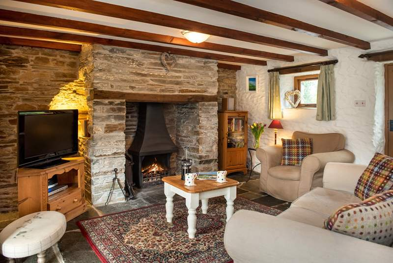 The lounge is snug and cosy and the wood-burner makes it an ideal retreat all year round.