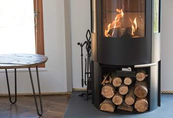 A cosy wood-burner suppliments the under-floor heating.